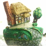 3D cross-stitch pin cushion hill and cottage