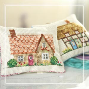 Tiny cross-stitch cushion_ Holly Hawthorn's Cottage & Holly Hawthorn's Cottage_£6 each